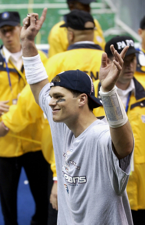. New England Patriots quarterback Tom Brady waves to the crowd at the Louisiana Superdome after being named MVP of Super Bowl XXXVI on Sunday, Feb. 3, 2002, in New Orleans. The Patriots beat the St. Louis Rams 20-17 on a field goal in the closing seconds of the game. (AP Photo/Kathy Willens)