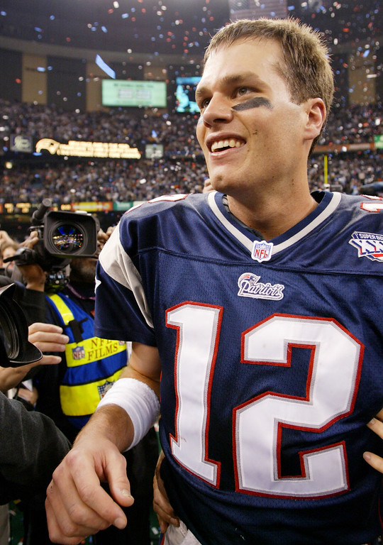 . New England Patriots quarterback Tom Brady (12) celebrates after the Patriots beat the St. Louis Rams 20-17  in Super Bowl XXXVI at the Louisiana Superdome, Sunday, Feb. 3, 2002, in New Orleans. Brady was named MVP. (AP Photo/Doug Mills)