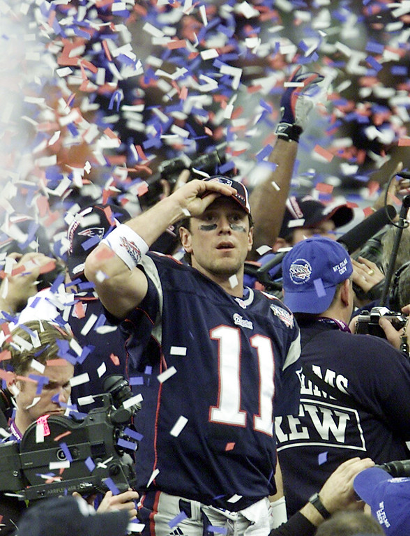 . New England Patriots quarterback Drew Bledsoe (11) is covered up in confetti after the Patriots beat the St. Louis Rams in Super Bowl XXXVI at the  Louisiana Superdome Sunday, Feb. 3, 2002 in New Orleans.  (AP Photo/Beth A. Keiser)