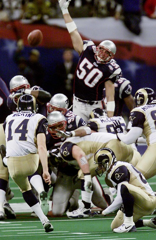 . New England Patriots\' Mike Vrabel (50) can\'t get to the ball as St. Louis Rams kicker Jeff Wilkins (14) kicks a first-quarter field goal during Super Bowl XXXVI at the  Louisiana Superdome Sunday, Feb. 3, 2002 in New Orleans.  (AP Photo/Beth A. Keiser)