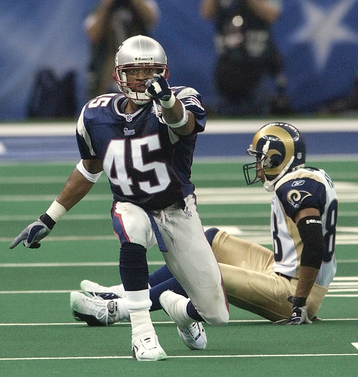 . New England Patriots cornerback Otis Smith celebrates after knocking down a pass intended for St. Louis Rams receiver Torry Holt during the fourth quarter of Super Bowl XXXVI, Sunday, Feb. 3, 2002, in New Orleans. (AP Photo/Kathy Willens)