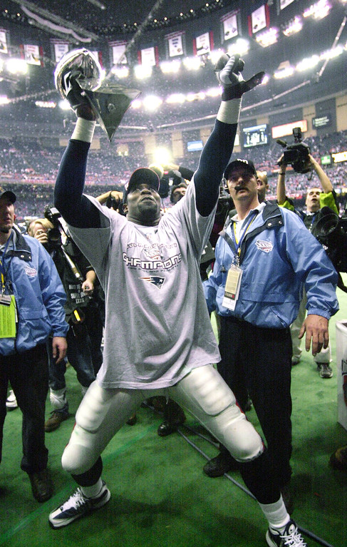 . New England Patriots defensive end Bobby Hamilton celebrates with the trophy after the Patriots defeated the St. Louis Rams in Super Bowl XXXVI at the  Louisiana Superdome Sunday, Feb. 3, 2002 in New Orleans.  (AP Photo/Steven Senne)