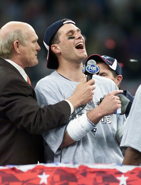 . New England Patriots quarterback Tom Brady talks with Terry Bradshaw, left, after being name MVP of the Super Bowl, Sunday, Feb. 3, 2002, in New Orleans. The Patriots beat the St. Louis Rams 20-17. (AP Photo/Michael Conroy)
