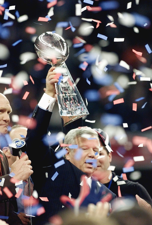 . New England Patriots owner Robert Kraft holds the Vince Lombardi Trophy aloft after the Patriots won the Super Bowl, 20-17 over the St. Louis Rams Sunday, Feb. 3, 2002, in New Orleans. (AP Photo/Michael Conroy)