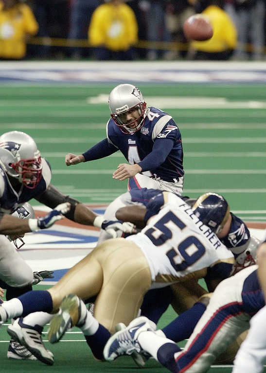 . New England Patriots kicker Adam Vinatieri kicks his game-winning 48-yard field goal in the final seconds to beat the St. Louis Rams 20-17 in Super Bowl XXXVI, Sunday, Feb. 3, 2002, in New Orleans. (AP Photo/Kathy Willens)