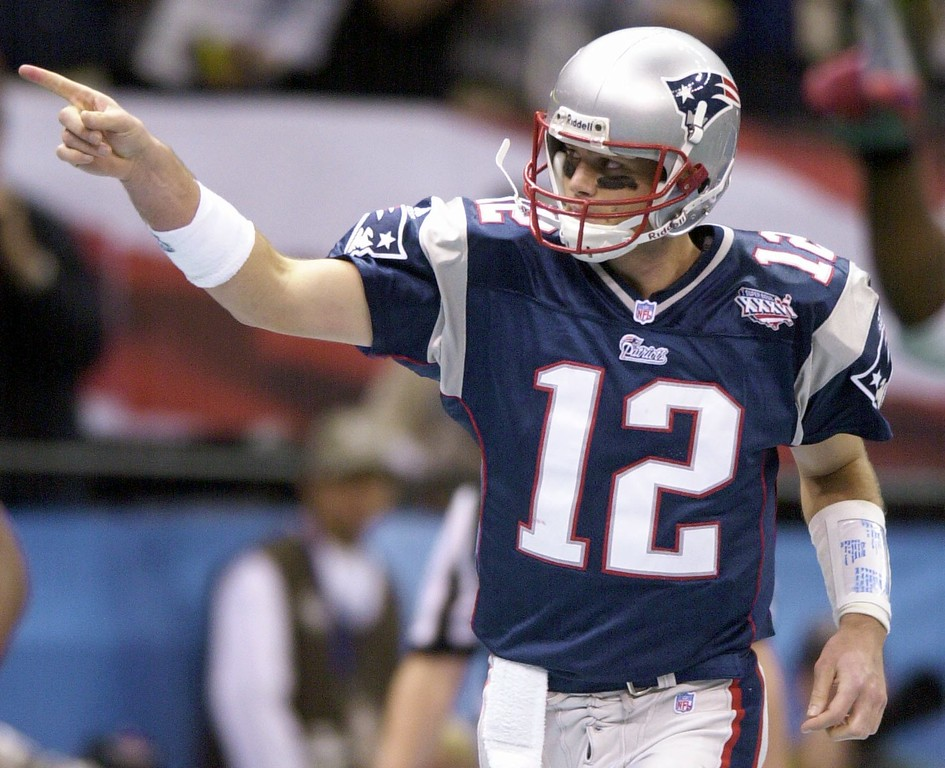 . New England Patriots quarterback Tom Brady (12) reacts to a second-quarter touchdown play during Super Bowl XXXVI at the  Louisiana Superdome Sunday, Feb. 3, 2002 in New Orleans.  (AP Photo/Steven Senne)