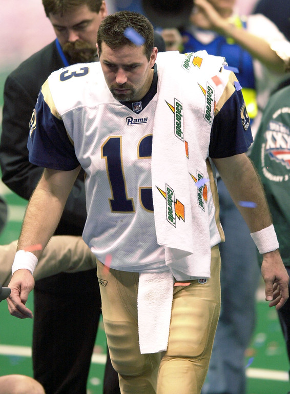 . St. Louis Rams quarterback Kurt Warner (13) leaves the field after the New England Patriots won Super Bowl XXXVI at the  Louisiana Superdome Sunday, Feb. 3, 2002 in New Orleans.  (AP Photo/Tony Gutierrez)