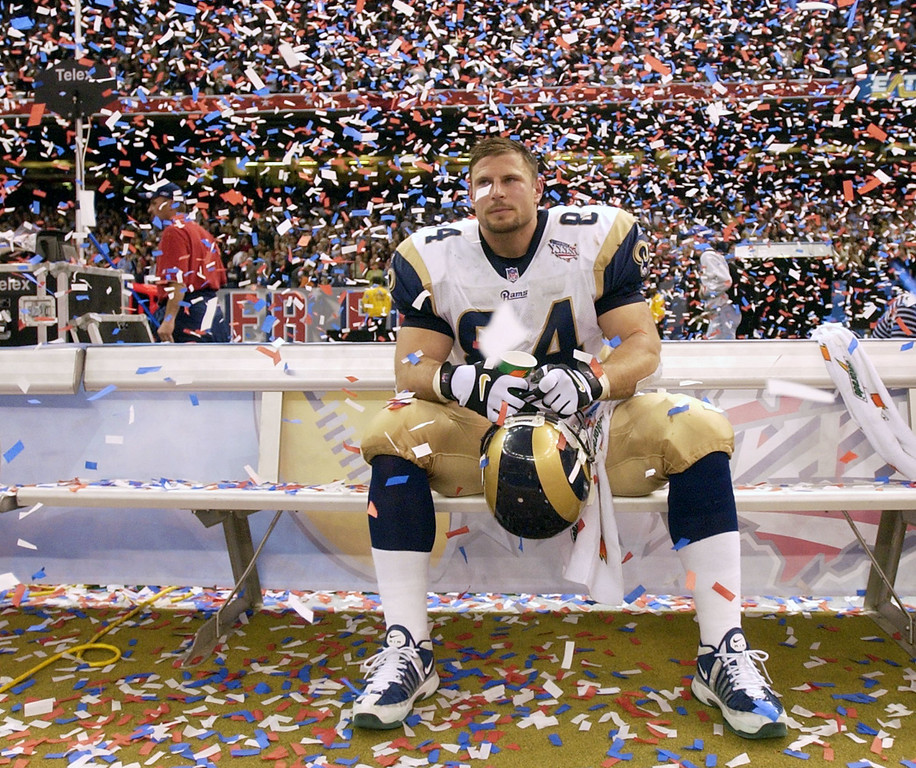 . St. Louis Rams\' Ernie Conwell sits dejectedly in the  confetti shower after the Rams lost Super Bowl XXXVI to the New England Patriots 20-17 Sunday, Feb. 3, 2002, in New Orleans. (AP Photo/David J. Phillip)