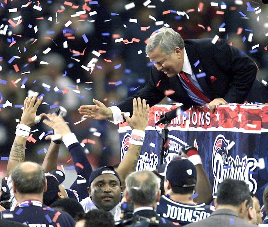 . New England Patriots owner Robert Kraft gets high fives from the podium after the Patriots beat the St. Louis Rams in Super Bowl XXXVI at the  Louisiana Superdome Sunday, Feb. 3, 2002 in New Orleans.  (AP Photo/Beth A. Keiser)