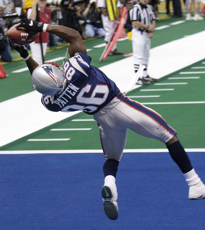 . New England Patriots wide receiver David Patten goes high for the touchdown grab in the second quarter against the St. Louis Rams during Super Bowl XXXVI, Sunday, Feb. 3, 2002, in New Orleans. (AP Photo/Kathy Willens)