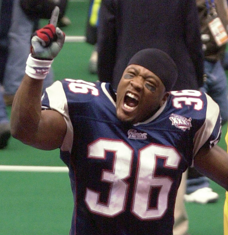 . New England Patriots Lawyer Milloy (36) celebrates the Patriots victory over the St. Louis Rams in Super Bowl XXXVI at the  Louisiana Superdome Sunday, Feb. 3, 2002 in New Orleans.  (AP Photo/Tony Gutierrez)