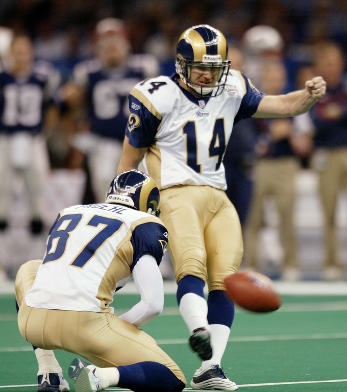 . St. Louis Rams kicker Jeff Wilkins (14) boots a 50-yard field goal out of the hold of Ricky Proehl (87) in the first quarter of Super Bowl XXXVI against the New England Patriots Sunday, Feb. 3, 2002, in New Orleans. (AP Photo/Rusty Kennedy)