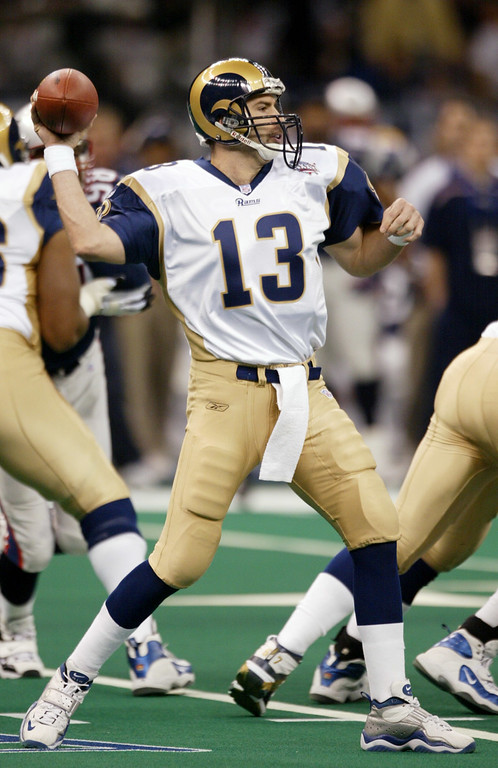. St. Louis Rams quarterback Kurt Warner (13) fires a pass against the New England Patriots during the first quarter of Super Bowl XXXVI Sunday, Feb. 3, 2002, in New Orleans. (AP Photo/Rusty Kennedy)