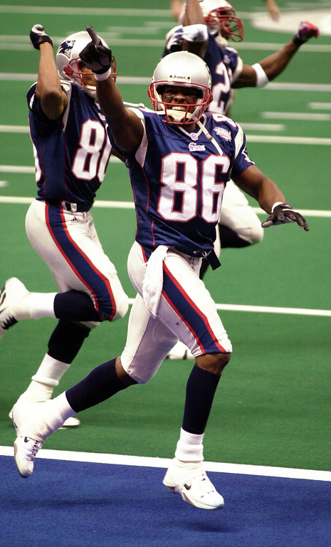 . New England Patriots wide receiver David Patten (86) and wide receiver Troy Brown (80) celebrate a second quarter touchdown against the St. Louis Rams at Super Bowl XXXVI at the  Louisiana Superdome Sunday, Feb. 3, 2002 in New Orleans.  (AP Photo/Tony Gutierrez)