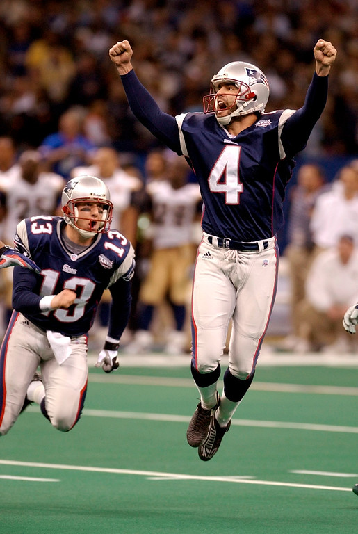 . New England Patriots\' kicker Adam Vinatieri celebrates his 48-yard game-winning field goal in the final seconds of Super Bowl XXXVI against the St. Louis Rams Sunday, Feb. 3, 2002 in New Orleans. At left is teammate Ken Walters. (AP Photo/Amy Sancetta)