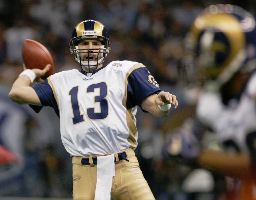 . St. Louis Rams quarterback Kurt Warner looks to pass to Marshall Faulk,  right,  in the first quarter against the New England Patriots in Super Bowl XXXVI at the Louisiana Superdome, Sunday, Feb. 3, 2002, in New Orleans. (AP Photo/Doug Mills)