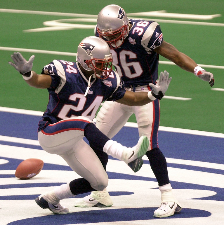 . New England Patriots cornerback Ty Law (24) celebrates his interception of a St. Louis Rams\' Kurt Warner pass for a touchdown in the second quarter of Super Bowl XXXVI with teammate Lawyer Milloy (36)  at the  Louisiana Superdome Sunday, Feb. 3, 2002 in New Orleans.  (AP Photo/Tony Gutierrez)