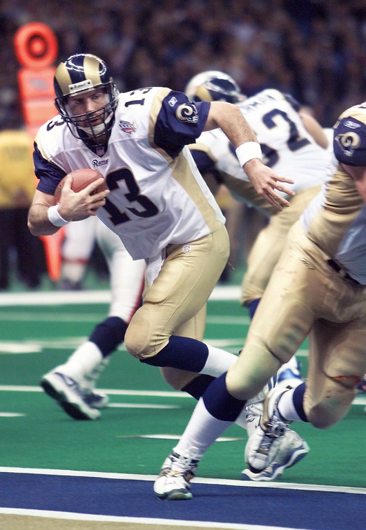 . St. Louis Rams quarterback Kurt Warner (13) runs two yards for a touchdown in the fourth quarter against the New England Patriots in Super Bowl XXXVI Sunday, Feb. 3, 2002, in New Orleans. (AP Photo/Michael Conroy)