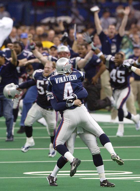 . New England Patriots\' Adam Vinatieri (4) is lifted into the air as his teammates charge the field after his game-winning 48-yard field goal beat the St. Louis Rams 20-17 in Super Bowl XXXVI, Sunday, Feb. 3, 2002, in New Orleans. (AP Photo/Kathy Willens)