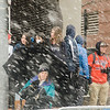 Dedicated Patriots fans wait in the snow and rain to catch a glimpse of the Patriots Super Bowl parade on Tuesday, February 7, 2017 in Boston. SENTINEL & ENTERPRISE / Ashley Green