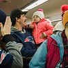 Tom Hatch and Olivia Peduzzi, of Northfield, aboard the early train from the new Wachusett Station into North Station for the Patriots Super Bowl parade on Tuesday, February 7, 2017. SENTINEL & ENTERPRISE / Ashley Green