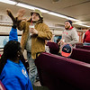 Harry Williams, of Gardner, hands out high-fives as local Pats fans board the early train from the new Wachusett Station into North Station for the Patriots Super Bowl parade on Tuesday, February 7, 2017. SENTINEL & ENTERPRISE / Ashley Green