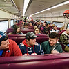 Local Pats fans board the early train from the new Wachusett Station into North Station for the Patriots Super Bowl parade on Tuesday, February 7, 2017. SENTINEL & ENTERPRISE / Ashley Green