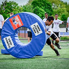Anthurny Neang of Lowell tackles some of the gear they provided at the Patritos Football Clinic for kids. SUN/Caley McGuane