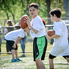 Bobby Ayotte of Pelham looks to pass the ball during a drill at the Patritos Football Clinic for kids. SUN/Caley McGuane