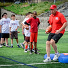 Former Patritos player, Steve Nelson teaches kids some football drills at the Patritos Football Clinic for kids. SUN/Caley McGuane