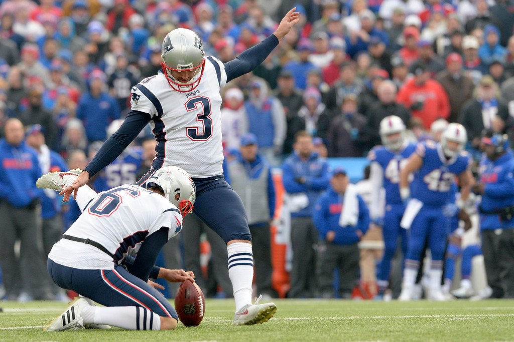 . New England Patriots kicker Stephen Gostkowski (3), with Ryan Allen holding, kicks a field goal against the Buffalo Bills during the first half of an NFL football game, Sunday, Dec. 3, 2017, in Orchard Park, N.Y. (AP Photo/Adrian Kraus)
