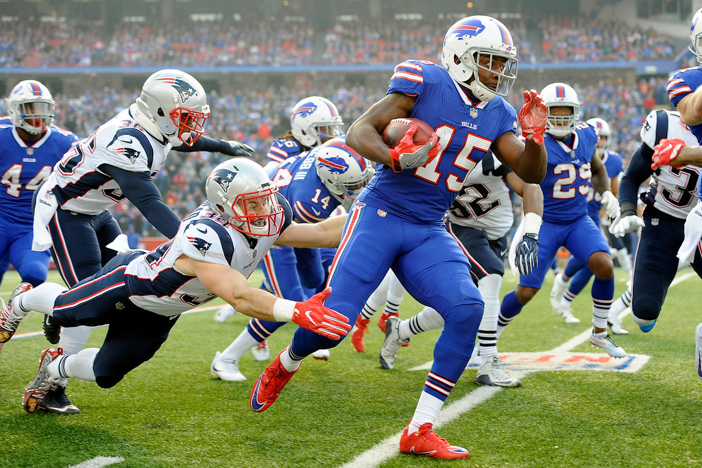 . Buffalo Bills\' Brandon Tate (15) returns the opening kickoff as New England Patriots\' Rex Burkhead (34) tries to stop him during the first half of an NFL football game, Sunday, Dec. 3, 2017, in Orchard Park, N.Y. (AP Photo/Adrian Kraus)