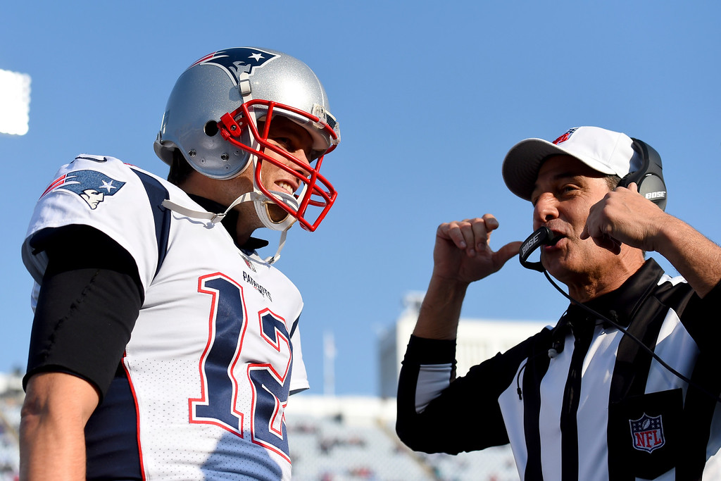 . New England Patriots quarterback Tom Brady, left, talks to referee Gene Steratore (114) prior to an NFL football game against the Buffalo Bills, Sunday, Dec. 3, 2017, in Orchard Park, N.Y. (AP Photo/Rich Barnes)