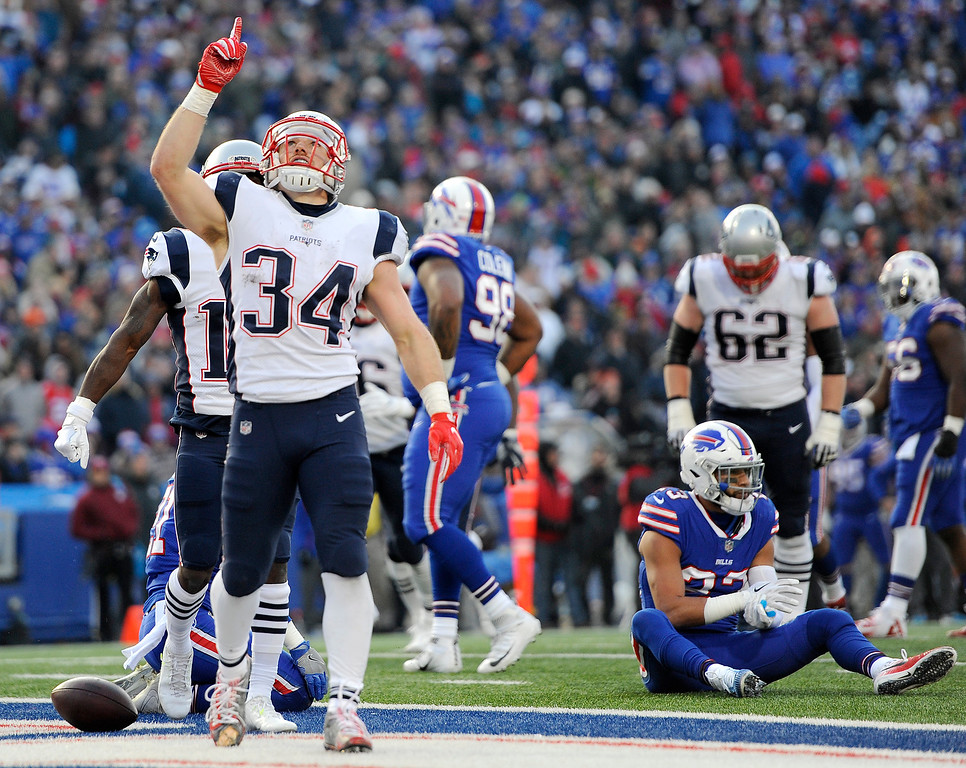 . New England Patriots running back Rex Burkhead (34) gestures after scoring a touchdown against the Buffalo Bills during the second half of an NFL football game, Sunday, Dec. 3, 2017, in Orchard Park, N.Y. (AP Photo/Adrian Kraus)