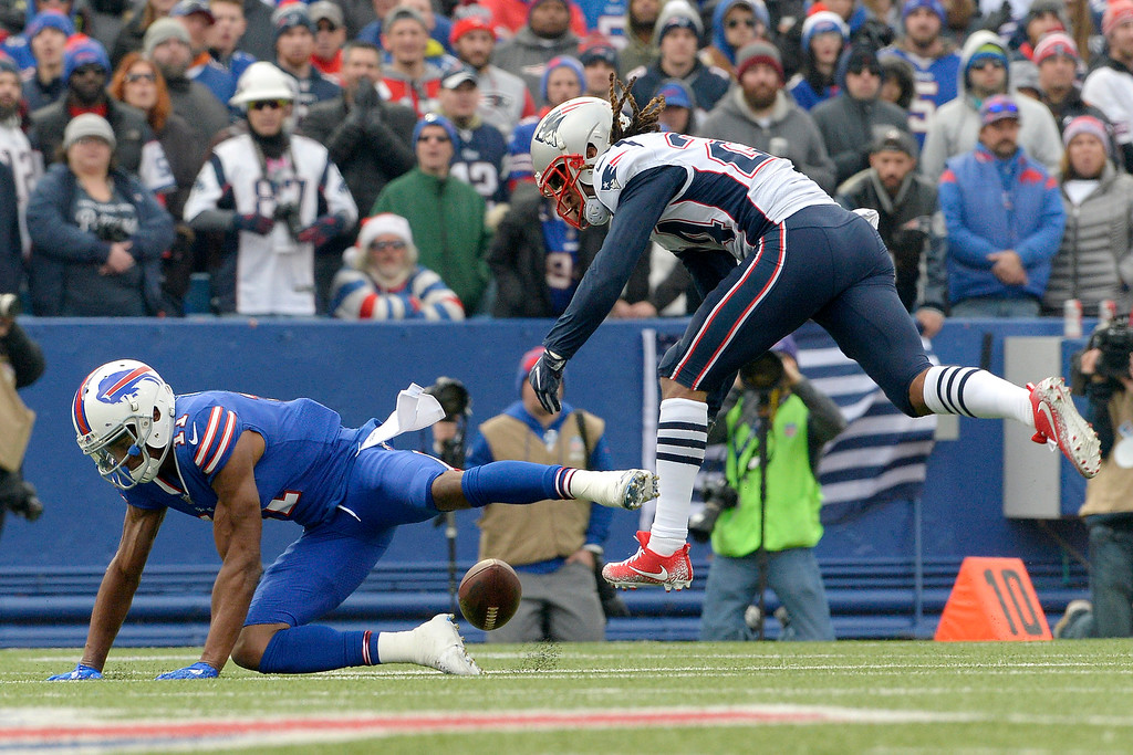 . New England Patriots cornerback Stephon Gilmore, right, breaks up a pass intended for Buffalo Bills wide receiver Zay Jones during the first half of an NFL football game, Sunday, Dec. 3, 2017, in Orchard Park, N.Y. (AP Photo/Adrian Kraus)