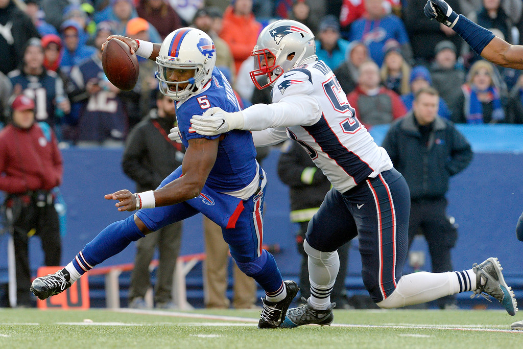 . Buffalo Bills quarterback Tyrod Taylor (5) is sacked by New England Patriots outside linebacker Kyle Van Noy (53) during the second half of an NFL football game, Sunday, Dec. 3, 2017, in Orchard Park, N.Y. (AP Photo/Adrian Kraus)
