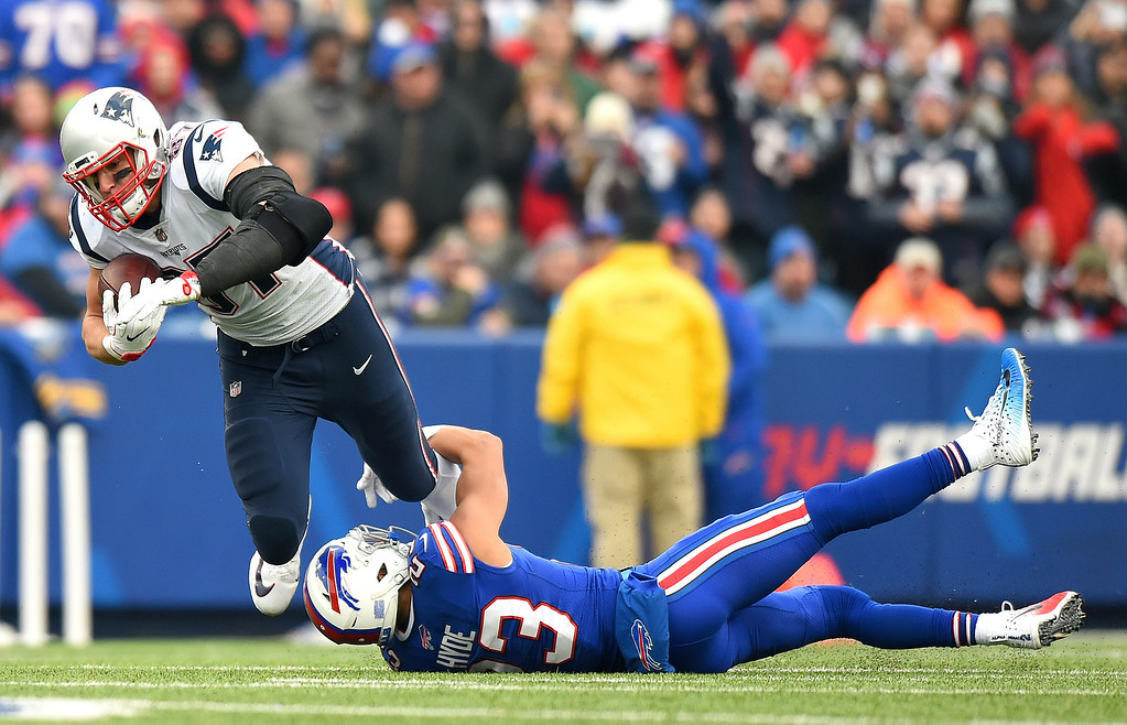 . New England Patriots tight end Rob Gronkowski (87) is tripped by Buffalo Bills strong safety Micah Hyde (23) during the first half of an NFL football game, Sunday, Dec. 3, 2017, in Orchard Park, N.Y. (AP Photo/Rich Barnes)