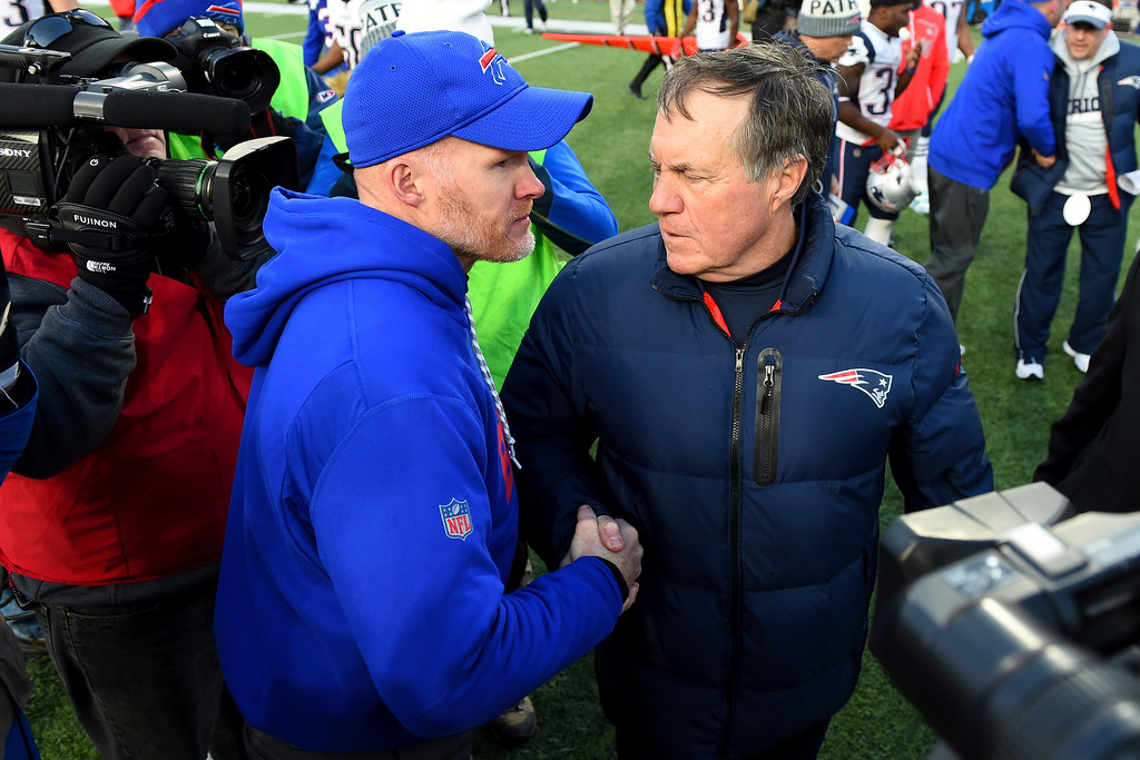 . Buffalo Bills head coach Sean McDermott, left, talks to New England Patriots head coach Bill Belichick after an NFL football game, Sunday, Dec. 3, 2017, in Orchard Park, N.Y. The Patriots won 23-3. (AP Photo/Rich Barnes)
