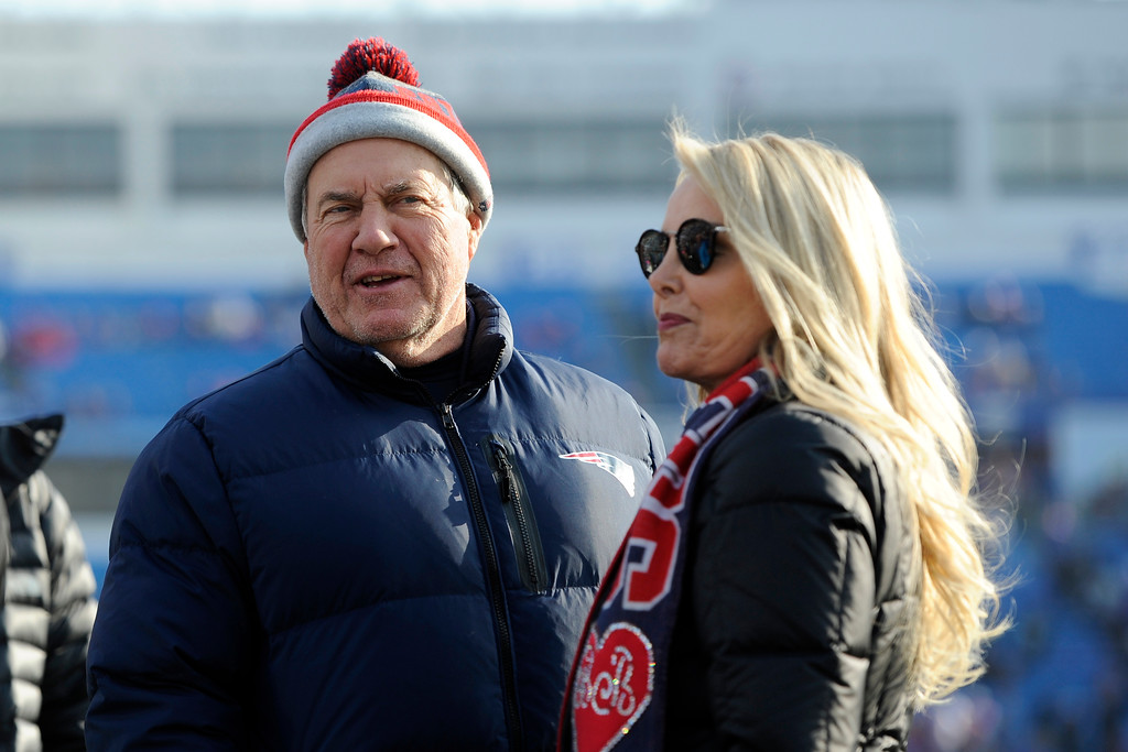 . New England Patriots head coach Bill Belichick stands with girlfriend Linda Holliday prior to an NFL football game against the Buffalo Bills, Sunday, Dec. 3, 2017, in Orchard Park, N.Y. (AP Photo/Adrian Kraus)