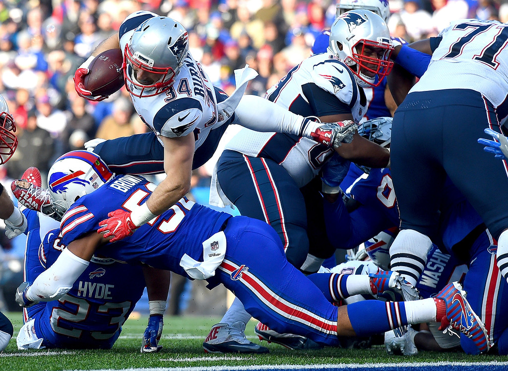 . New England Patriots running back Rex Burkhead (34) dives over Buffalo Bills middle linebacker Preston Brown (52) near the goal line during the second half of an NFL football game, Sunday, Dec. 3, 2017, in Orchard Park, N.Y. (AP Photo/Rich Barnes)
