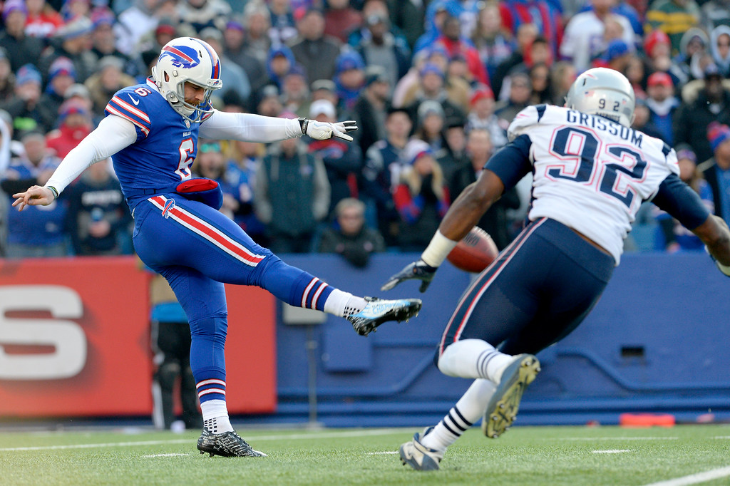 . Buffalo Bills punter Colton Schmidt (6) kicks as New England Patriots defensive end Geneo Grissom tries to block the kick during the second half of an NFL football game, Sunday, Dec. 3, 2017, in Orchard Park, N.Y. (AP Photo/Adrian Kraus)