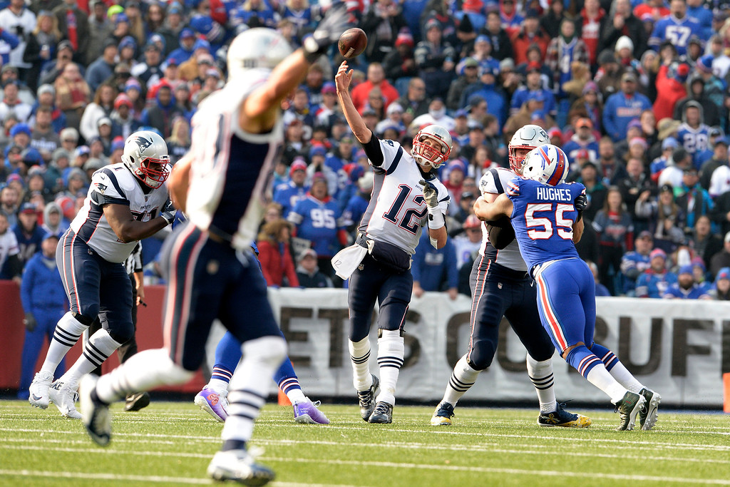 . New England Patriots quarterback Tom Brady (12) throws a pass against the Buffalo Bills during the first half of an NFL football game, Sunday, Dec. 3, 2017, in Orchard Park, N.Y. (AP Photo/Adrian Kraus)