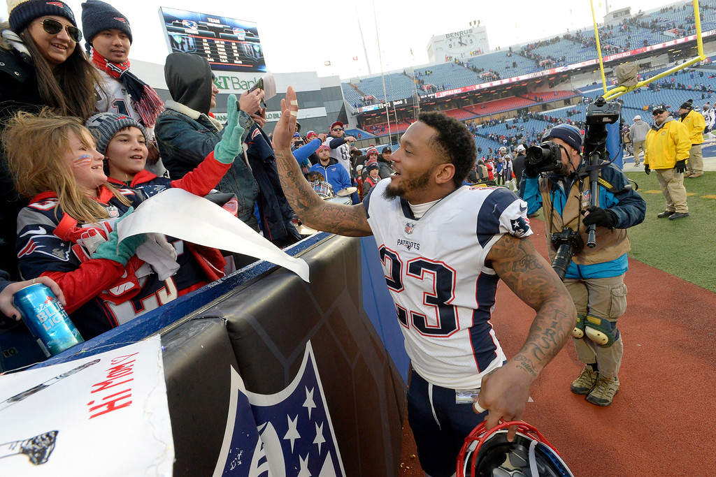 . New England Patriots strong safety Patrick Chung acknowledges spectators after an NFL football game against the Buffalo Bills, Sunday, Dec. 3, 2017, in Orchard Park, N.Y. The Patriots won 23-3. (AP Photo/Adrian Kraus)