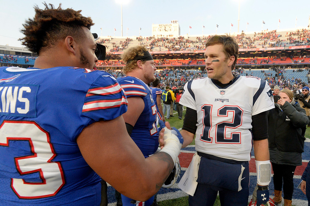 . Buffalo Bills offensive tackle Dion Dawkins, left, talks to New England Patriots quarterback Tom Brady after an NFL football game, Sunday, Dec. 3, 2017, in Orchard Park, N.Y. The Patriots won 23-3. (AP Photo/Adrian Kraus)