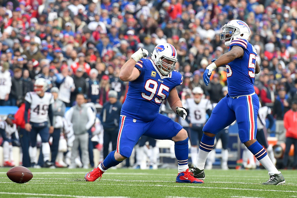 . Buffalo Bills defensive tackle Kyle Williams (95) celebrates with teammate defensive end Jerry Hughes (55) after Williams sacked New England Patriots quarterback Tom Brady during the first half of an NFL football game, Sunday, Dec. 3, 2017, in Orchard Park, N.Y. (AP Photo/Rich Barnes)