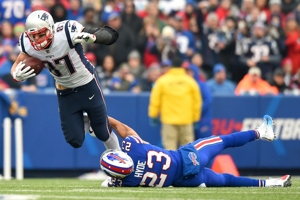 . New England Patriots tight end Rob Gronkowski (87) is tripped up by Buffalo Bills strong safety Micah Hyde (23) during the first half of an NFL football game, Sunday, Dec. 3, 2017, in Orchard Park, N.Y. (AP Photo/Rich Barnes)