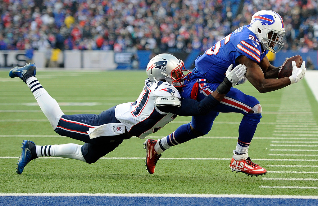. Buffalo Bills running back LeSean McCoy, right, runs with the ball as New England Patriots strong safety Jordan Richards (37) makes a tackle during the second half of an NFL football game, Sunday, Dec. 3, 2017, in Orchard Park, N.Y. (AP Photo/Adrian Kraus)