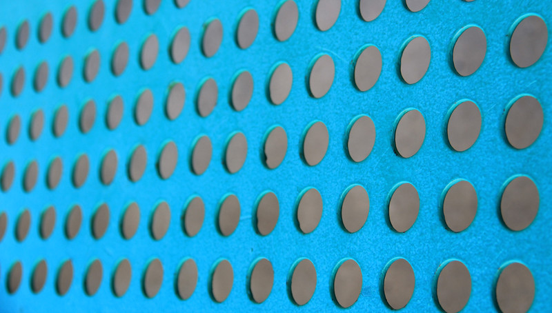Turquoise Abstract Background with Gray Holes or Stubs?