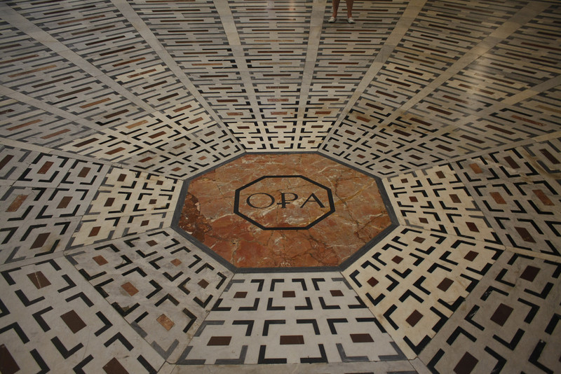 "Well-like illusion of floor taken with wide-angle lens from near floor.   The 15th century ""The Duomo"" or Basilica of St. Mary in Florence, Italy."