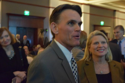 Macomb County Executive Mark Hackel (center) joined by Michigan Secretary of State Ruth Johnson (right) at Oakland County Executive L. Brooks Patterson's 2017 State of the County Address in Pontiac on Wednesday, Feb. 8, 2017. (Mark Cavitt/The Oakland Press)